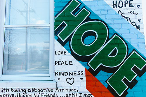 Part of a Giving Wall mural showing the word Hope