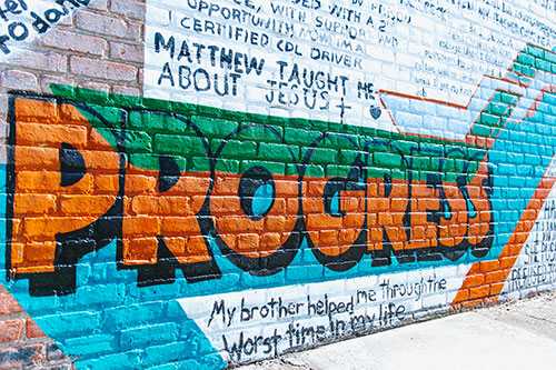 Part of a Giving Wall mural showing the word Progress