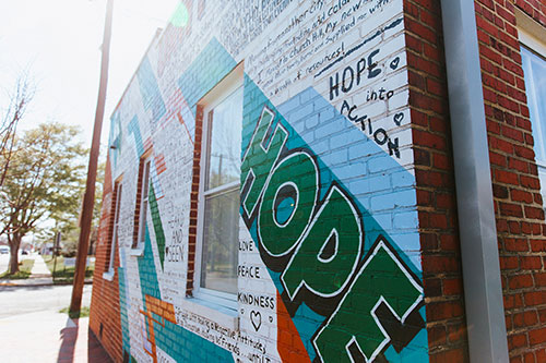 A giving wall mural featuring the message 'Hope'